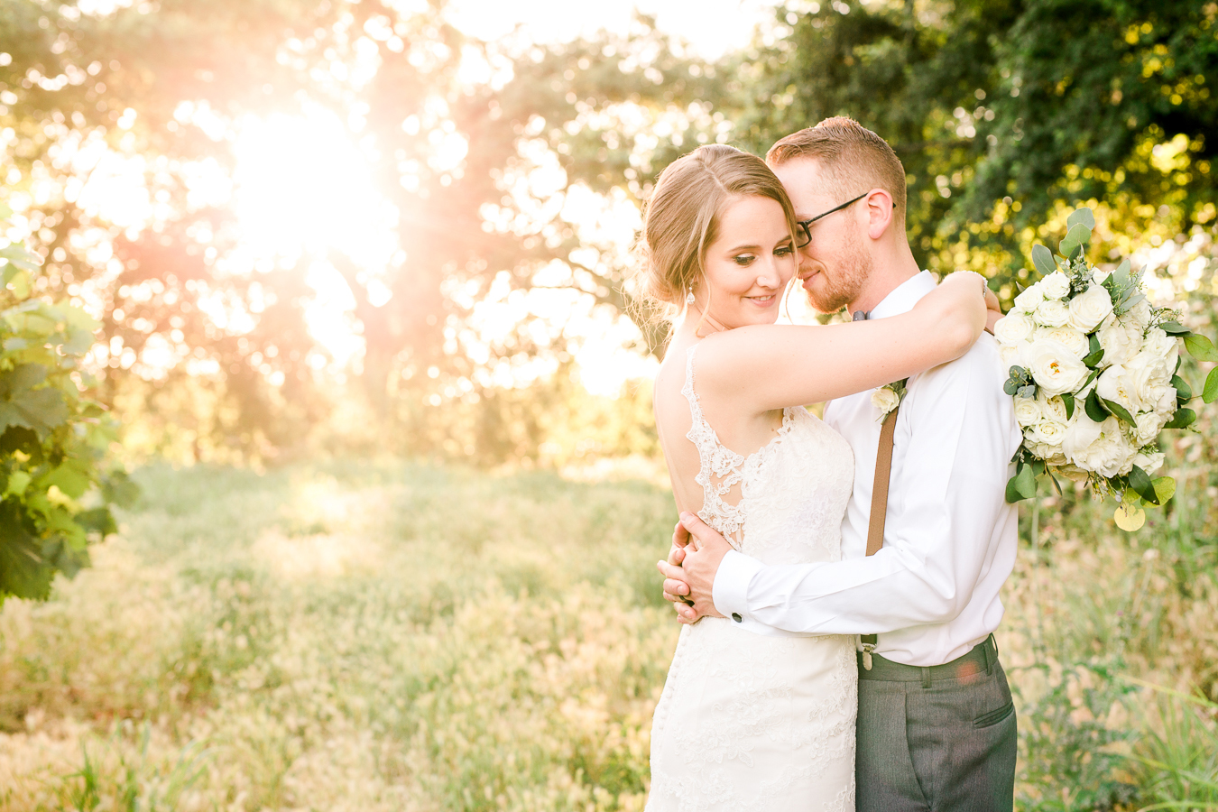 Bride and groom embracing during golden hour
