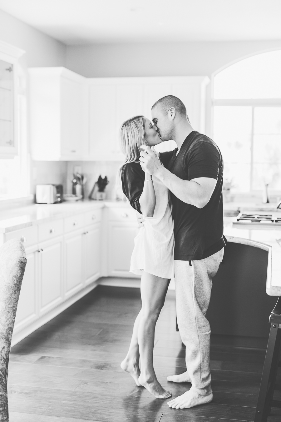 boy and girl kissing and dancing in the kitchen